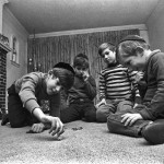 Jewish boys play with dreidel, Brookline