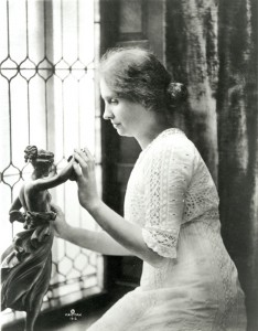 Helen Keller investigating statue, from the Helen Keller Collection from Perkins School for the Blind