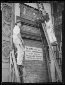 Removing bronze plaque for war drive